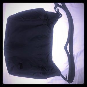 Pacsafe cross body bag. Black